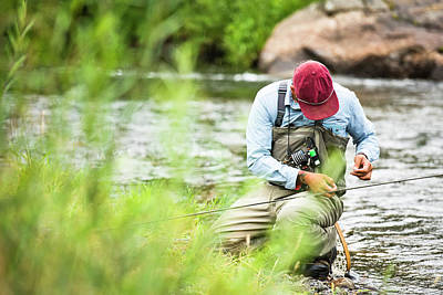 Colorado Fly Fishing River Wall Art - Photograph - A Fly Fisherman Prepares His Gear While by Rob Hammer