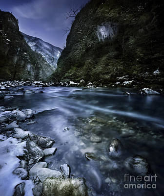 A River Flowing Through The Snowy Art Print by Evgeny Kuklev