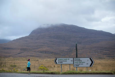 Torridon Wall Art - Photograph - Adult Woman Road Running by Woods Wheatcroft