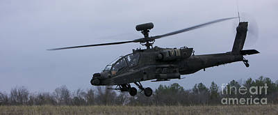 Down On The Ground Photograph - An Ah-64 Apache Helicopter In Midair by Terry Moore