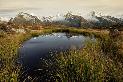 An Alpine Lake Print by Lorenzo Tonello