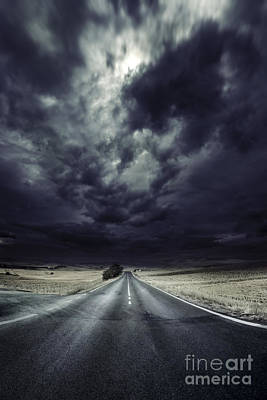 An Asphalt Road With Stormy Sky Above Art Print by Evgeny Kuklev