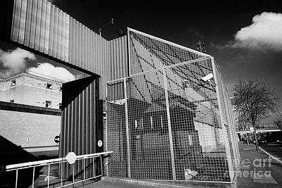 anti rpg cage surrounding observation sanger at North Queen Street PSNI police station Belfast North Art Print by Joe Fox