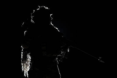 Photograph - Backlit Contour Silhouette Of Army by Oleg Zabielin