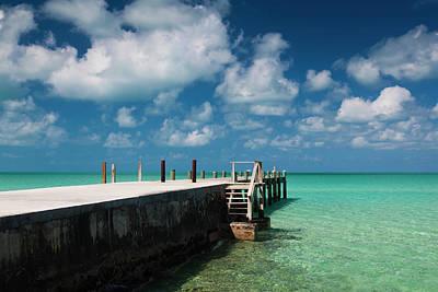 Bahamas Pier Photograph - Bahamas, Eleuthera Island, Tarpum Bay by Walter Bibikow