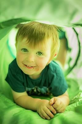Candid Photograph - Boy In Green Tunnel by Samuel Ashfield