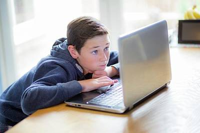 Candid Photograph - Boy Using A Laptop by Samuel Ashfield