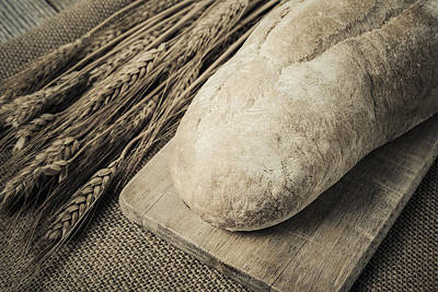 Bread On Bread Board With Wheat On Burlap Background Art Print by Brandon Bourdages