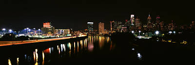 Buildings Lit Up At The Waterfront Art Print by Panoramic Images