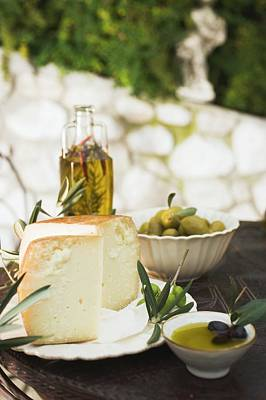 Cheese, Olives And Olive Oil On Table Out Of Doors Art Print