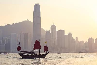 Junk Boat Photograph - Chinese Junk Boat Sailing In Hong Kong Harbor by Matteo Colombo