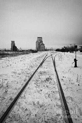 Cn Canadian National Railway Tracks And Grain Silos Kamsack Saskatchewan Canada Art Print by Joe Fox