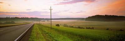 Telephone Poles Photograph - Country Road Passing Through A Field by Panoramic Images