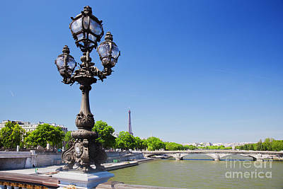 Paris Skyline Royalty-Free and Rights-Managed Images - Eiffel Tower and bridge on Seine river in Paris by Michal Bednarek