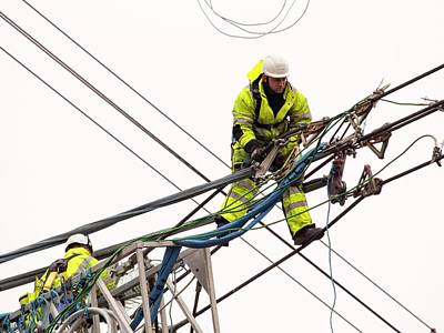 Engineers Working On Electricity Wires Art Print