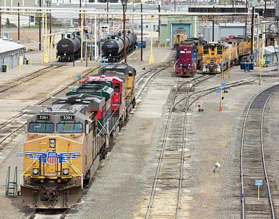 Freight Trains At A Rail Yard Art Print by Jim West