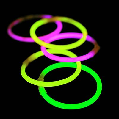 Glow Bracelets Art Print by Science Photo Library