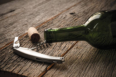 Wine Photograph - Green Wine Bottle And Cork With Red Wine And Corkscrew by Brandon Bourdages