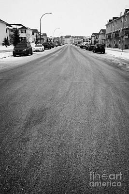 gritted salted cleared road in a residential housing suburbian development Saskatoon Saskatchewan Ca Art Print
