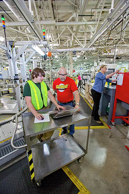 Factory Photograph - Intern Working At A Car Factory by Jim West
