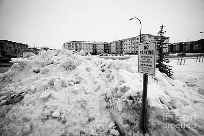 large pile of snow for collection cleared from residential streets Saskatoon Saskatchewan Canada Print by Joe Fox