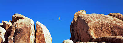 Tightrope Walking Photograph - Low Angle View Of A Person Walking by Panoramic Images
