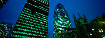 Gherkin Photograph - Low Angle View Of Buildings Lit by Panoramic Images