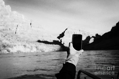 man taking photos with smartphone during boat ride along the colorado river in the grand canyon Ariz Art Print