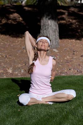 Photograph - Mature Woman Exercising by Gunter Nezhoda
