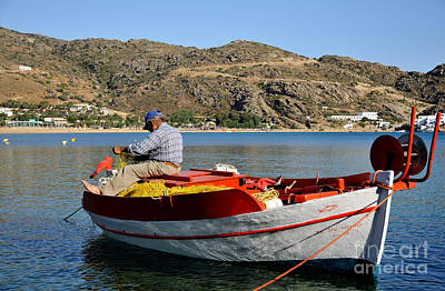 Photograph - Fisherman In Mylopotas Beach by George Atsametakis
