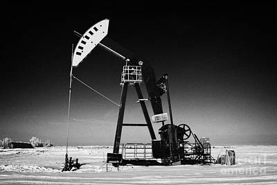 oil pumpjack in winter snow Forget Saskatchewan Art Print by Joe Fox