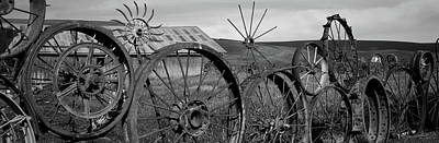 Black Metal Fence Photograph - Old Barn With A Fence Made Of Wheels by Panoramic Images