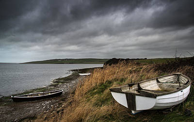 Old Decayed Rowing Boats On Shore Of Lake With Stormy Sky Overhe Art Print by Matthew Gibson