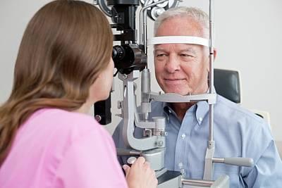 Optician Testing Man's Eyesight Art Print by Science Photo Library