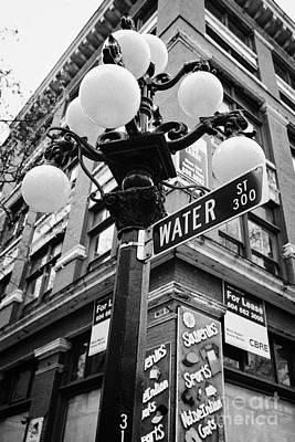 Streetlight Photograph - ornate streetlights in historic gastown district of Vancouver BC Canada by Joe Fox