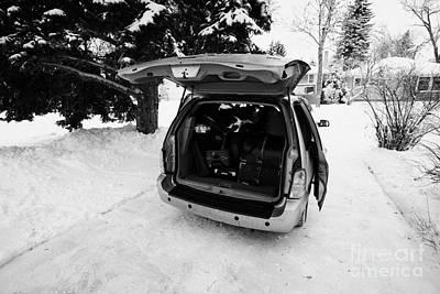 packing musicians equipment into mpv vehicle in Regina Saskatchewan Canada Art Print