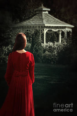 Photograph - Rear View Of A Woman Looking Towards A Gazebo At Night by Sandra Cunningham