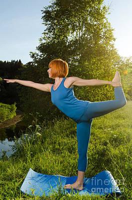 Polaroid Camera - Red woman practicing fitness yoga by Nikita Buida