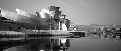 Gehry Photograph - Reflection Of A Museum On Water by Panoramic Images