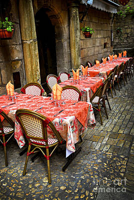 Wine Royalty-Free and Rights-Managed Images - Restaurant patio in France by Elena Elisseeva