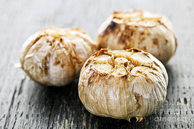 Roasted Garlic Bulbs Art Print by Elena Elisseeva