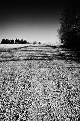 Gravel Road Photograph - rough rural unpaved gravel road in remote Saskatchewan Canada by Joe Fox