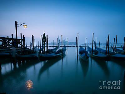 Italy Photograph - Row Of Gondolas At Sunrise Venice Italy by Matteo Colombo