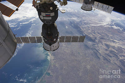 Kim Fearheiley Photography Royalty Free Images - Russian Spacecraft Docked Royalty-Free Image by Stocktrek Images