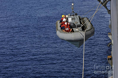 Inflatable Photograph - Sailors Lower A Rigid-hull Inflatable by Stocktrek Images