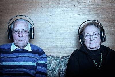 Senior Couple Wearing Headphones Art Print