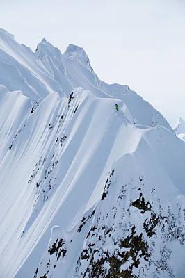 Skier Standing On Snowy Mountain Ridge Art Print