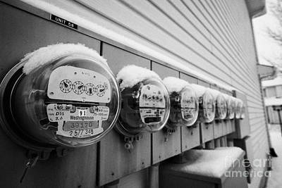 snow covered electricity meters in Saskatoon Saskatchewan Canada Print by Joe Fox