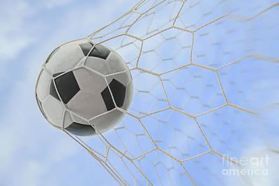 Netting Photograph - Soccer Ball In Goal by Anek Suwannaphoom
