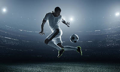 Soccer Player Kicking Ball In Stadium Art Print by Dmytro Aksonov